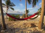 Enjoy over 10 hammocks on the property!