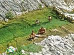 A bath in cristal clear Apennine creek