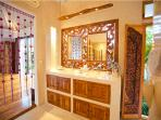 Ornately wooden carved swivel mirrors to allow airflow and light, with a/c in the bathroom