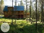 Aloha Mountain Hale is a beautiful cabin in the woods.