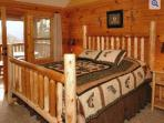 Master Bedroom 1 Offers a Comfortable Custom Made King Log Bed