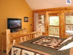 Master Bedroom 1 with large flat screen HDTV and door out to large deck with view