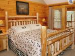 Master Bedroom 2 Offers a Comfortable Custom Made King Log Bed