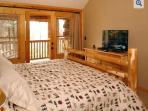 Master Bedroom 2 with large flat screen HDTV and door out to large deck with view