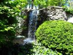The waterfall is only a short walk down the garden path.