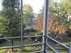 Porch view of sunrise hitting the secret garden in late fall.