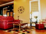 Front living room provides an area for people to relax and visit