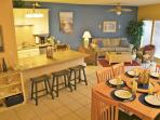Open concept Living Rm, Dining Rm and Kitchen.  You will find a 48 inch flat screen TV for viewing.