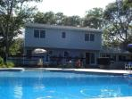 Back of the house - deck, hot tub, and pool