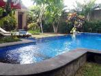 View pool garden and entrance door villa