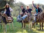 When on a donkey trek, travelers ride side-saddle on gentle, well-kept animals