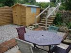 Private rear patio garden with seating/dining furniture/swing hammock/garden shed with bikes/BBQ