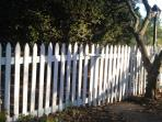 Charming white picket fence- parking area