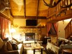Living Room with Large customade Stone Fireplace Wood Burning with Flatscreen Smart TV
