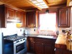 Kitchen with Granite Counter Tops and wooden Bar