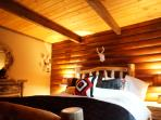 Master Bedroom with Log Wall and HD Flat Screen TV with Cable DVR very quiet and romantic