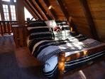 Loft Bedroom with Ralph Lauren Adobe Bedding with Balcony very quietly situated