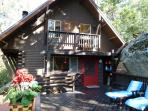 Boulder Creek Cottage with large deck, BBQ, and table.