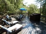 Large deck with propane BBQ, lounge chairs, umbrella