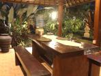 Dining pavilion set in the middle of our family compound looking over the lush garden