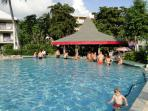Swimming pool area with swim up bar