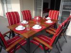 Dining table set with tableware, cutlery and glassware present in this poolvilla.