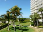 Ideally situated beachfront condo w/ heated pool & two separate balconies