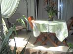 garden view lanai with table/3 chairs and an easy chair