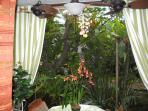 Garden view lanai has a double fan for cool breezes
