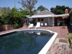 Solar heated pool and entertainment area