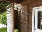 Outside enclosed hot & cold shower. Direct access to house through garage.