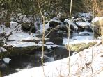 Creekside Cottage waterfall in winter