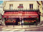 In front of my windows . Amelie's famous Grocery where you can find anything you need.Open every day