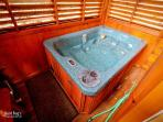Take a soak in the very private hot tub that is located in an en