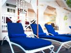 Loungers with cushions and umbrellas on the sun deck