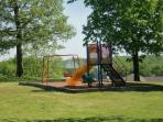 Playground and lots of surrounding green space
