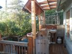 Coverd kitchen with propane BBQ,, small fridge and sink