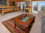 Downstairs is another sitting area and game area; like another master suite!