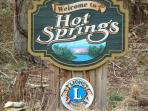 The Chestnut Log Cabin and town of Hot Springs sign by City Sign Artisans, Seneca SC