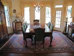 Formal dining room easily seats 8 with views of the lake and door to brick patio under pergola