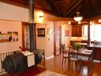 Gateway Stay Redwood Great Room Living & Dining Area, Historic Wood Stove