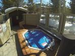 One of two hot tubs on the property. Just  steps away from the unit!