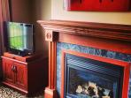 Flat screen TV & fireplace in the living room
