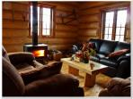 The living room, warm, rustic and comfortable