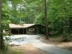 Stoney Creek Cabin is nestled in the woods & has plenty of parking and a carport