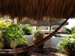 palapa terrace with hammocks and ocean views