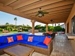 HUGE covered patio w/ super comfy couches - great for hanging out! TV mounted across from couch!