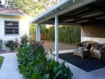 gated backyard and carport sitting