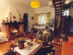 living romm with a sofa chair dining area and fireplace