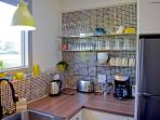 Coffee station, dimmable lights, modern faucets, refined glassware, electric kettle, & more!